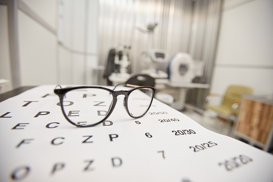 Prescription glasses and a chart in ophthalmology office