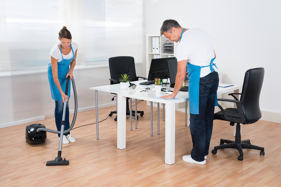 Workers of a great office cleaning company in Sydney while working